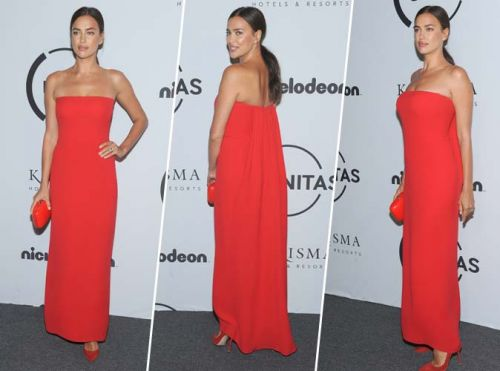 Irina Shayk:  Robe bustier, minaudière, escarpins. on craque pour son total look rouge !